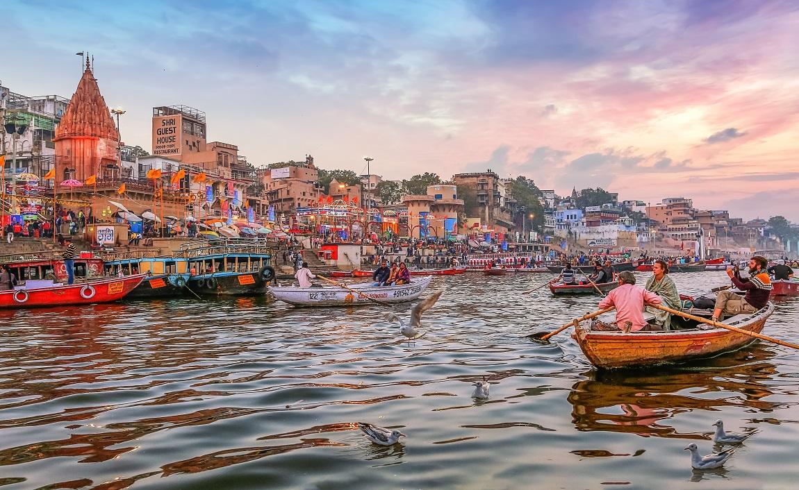 Varanasi-India-January-232019-Dashaswamedh-Ganges-river-ghat-Varanasi-at-twilight-with-tourists-enjoying-boating-rides.jpg